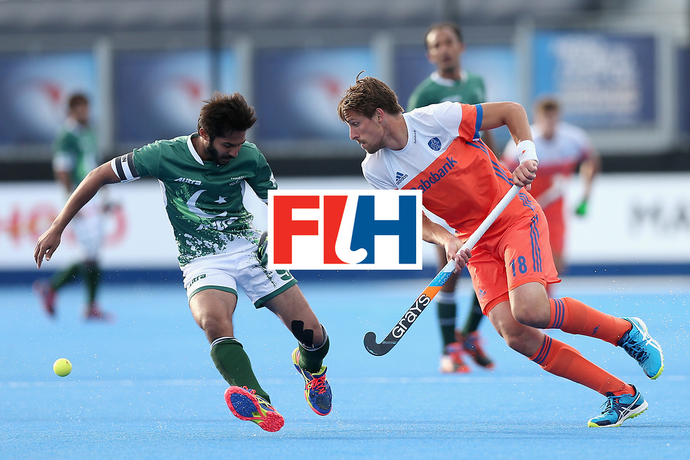 LONDON, ENGLAND - JUNE 15:  Bjorn Kellerman of the Netherlands takes the ball past Abdul Khan of Pakistan during the Hero Hockey World League Semi Final match between Netherlands and Pakistan at Lee Valley Hockey and Tennis Centre on June 15, 2017 in London, England.  (Photo by Alex Morton/Getty Images)