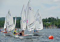 Lake Winnipesaukee Sailing Association hosts their annual regatta from Winnipesaukee Yacht Club.  Young racers round the buoy in the Opti sailboat class on Saunders Bay Thursday morning.  (Karen Bobotas/for the Laconia Daily Sun)