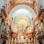 Panoramic shot of the interior and altar of the Baroque Karlskirche in Vienna, Austria