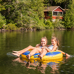 Kids swimming in Island Pond at Red River Camps in Aroostook County, Maine. Deboullie Public Reserve Land.