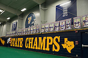 Banners of the current roster and reminders of the five state championships hang in the practice facility at Stephenville High School in Stephenville, Texas on November 5, 2013. Current Baylor head coach Art Briles won the first four state championships for Stephenville in the 1990's with current Stephenville coach Joseph Gillespie winning the first since the Briles era last season. (Cooper Neill / for The New York Times)