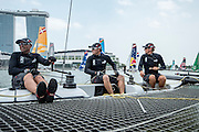 James Dagg, Glenn Ashby and Dean Barker. Emirates Team New Zealand practice for the first of the Extreme Sailing Series regattas being sailed in Singapore. 19/2/2014