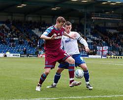 BURY, ENGLAND - Saturday, March 31, 2012: Tranmere Rovers' Ash Taylor in action against Bury's captain Steven Schumacher during the Football League One match at Gigg Lane. (Pic by Vegard Grott/Propaganda)