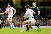 Ospreys outside half Dan Biggar tackles Stade Francais full-back Hugo Bonneval during the European Challenge Cup match between Ospreys and Stade Francais at Principality Stadium, Cardiff, Wales on 2 April 2017. Photo by Andrew Lewis.