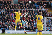 Leeds United striker, Chris Wood (9)  and Burnley defender Michael Keane (5)  challenge for the ball during the Sky Bet Championship match between Burnley and Leeds United at Turf Moor, Burnley, England on 9 April 2016. Photo by Simon Davies.