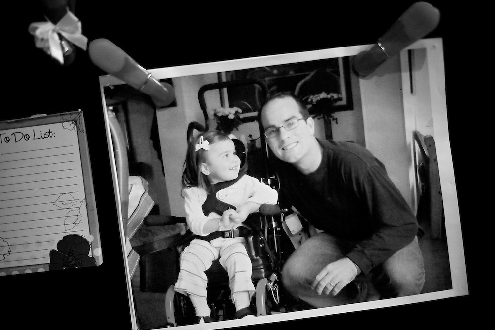 "Refrigerator magnets hold a photo of David Kennison with his daughter, Ellie, who passed away from Rett syndrome, a neurological disorder. ""This is the real depressing part of it: You're really stuck with trying answer the question - how do I live life without her?"" Kennison said. ""'Cause they're not here."""