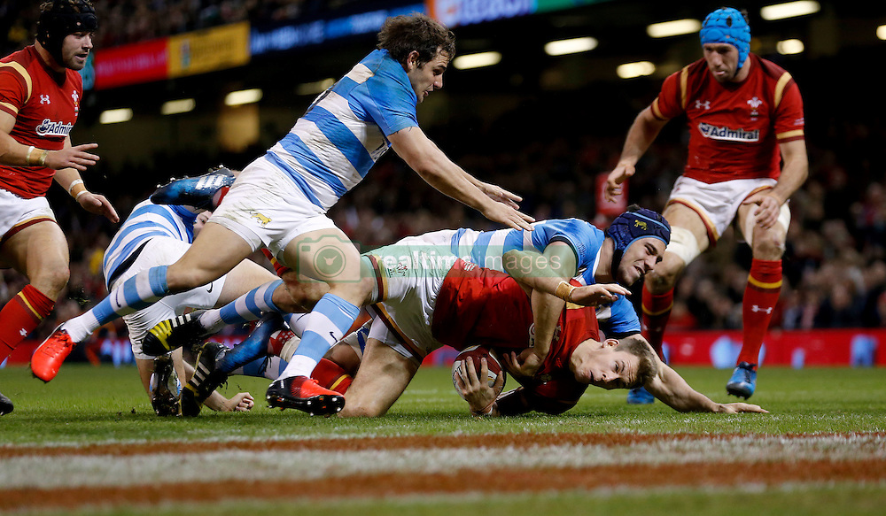 Wales' Liam Williams (bottom) scores his team's first try during the Autumn International match at the Principality Stadium, Cardiff.