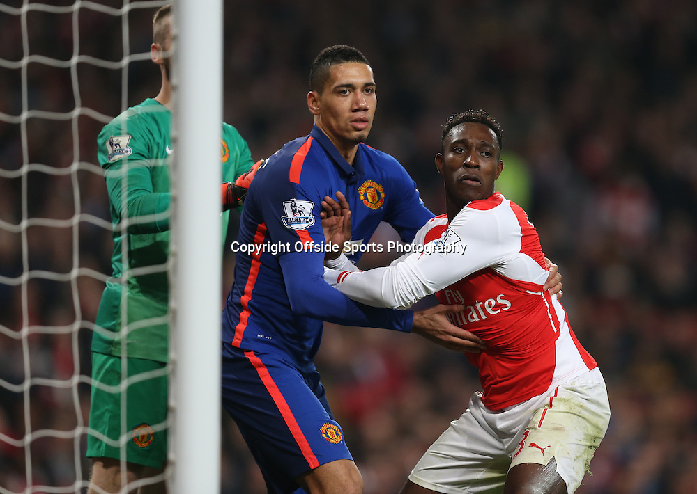 22 November 2014 - Barclays Premier League - Arsenal v Manchester United - Chris Smalling of Manchester United tangles with former team mate Danny Welbeck of Arsenal - Photo: Marc Atkins / Offside.