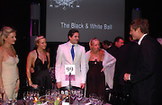 Fiona Scarry, Olympia Scarry, Edward Taylor, Astrid Harbord and Zac Goldsmith.  The Black and White Winter Ball. Old Billingsgate. London. 8 February 2006. -DO NOT ARCHIVE-© Copyright Photograph by Dafydd Jones 66 Stockwell Park Rd. London SW9 0DA Tel 020 7733 0108 www.dafjones.com