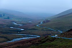 © Licensed to London News Pictures. 06/01/2018. Elan Valley, Powys, Wales, UK. A vehicle negotiates the mountain road in the Elan Valley between Rhayader in Powys Wales UK and Aberystwyth in Ceredigion Wales UK on a cold, foggy morning after temperatures dropped last night to freezing. There are many dangerous patches of ice on this mountain road this morning. Photo credit: Graham M. Lawrence/LNP