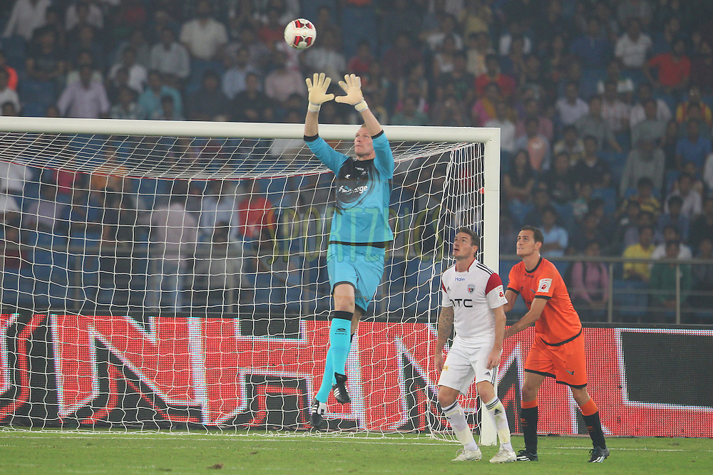 Delhi Dynamos FC goalkeeper Kristof Van Hout gathers the cross during match 16 of the Hero Indian Super League between The Delhi Dynamos FC and NorthEast United FC held at the Jawaharlal Nehru Stadium, Delhi, India on the 29th October 2014.<br /> <br /> Photo by:  Ron Gaunt/ ISL/ SPORTZPICS