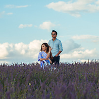 Couple smile from a lavender field.