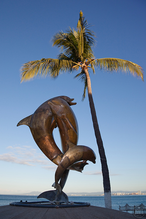 """The Dolphins"" - This statue of Dolphins was photographed at the Malecon in Puerto Vallarta, Mexico."