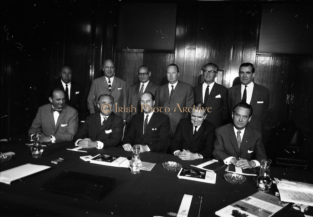 09/06/1967<br /> 06/09/1967<br /> 09 June 1967<br /> Hannover Chamber of Commerce members meet Mr. George Colley. A group from the Hannover (Germany) Chamber of Commerce were in Ireland on a study tour of the Industrial possibilities in this country. The group with members of the Industrial Development Authority were received by Mr. George Colley T.D., Minister for Industry and Commerce in the Council Chamber at the Department of Industry and Commerce, Kildare Street Dublin. Pictured are Front row (l-r): Dr. F.H. Hadicke, Chairman Foreign Section of the Chamber of Commerce; Herr Franz Thiemann, Vice President of the Chamber; Mr. George Colley T.D.; Mr. T.S. O'Neill, member of the IDA and Dr. Roland Grunzig, Irish Consul in Hannover. <br /> Back row: Dr. J.F. Zwicky, Ferdinand Rinne Shoe Factory; Herr Alfred Belling, Stahlkontor Weser-Gruppe Hameln Bosingfeld; Dr. Fritz Rudiger, Wallenberg printing machinery plant; Herr Johann Christoph Beindorff, Gunther Wagner Paliken Werhe, office equipment manufactures; Herr Ernst Stewnar, Rakoll-Werke Peschken ind Stewner Chemicals and Mr. Richard O'Farrell, Information Officer Industrial Development Authority.