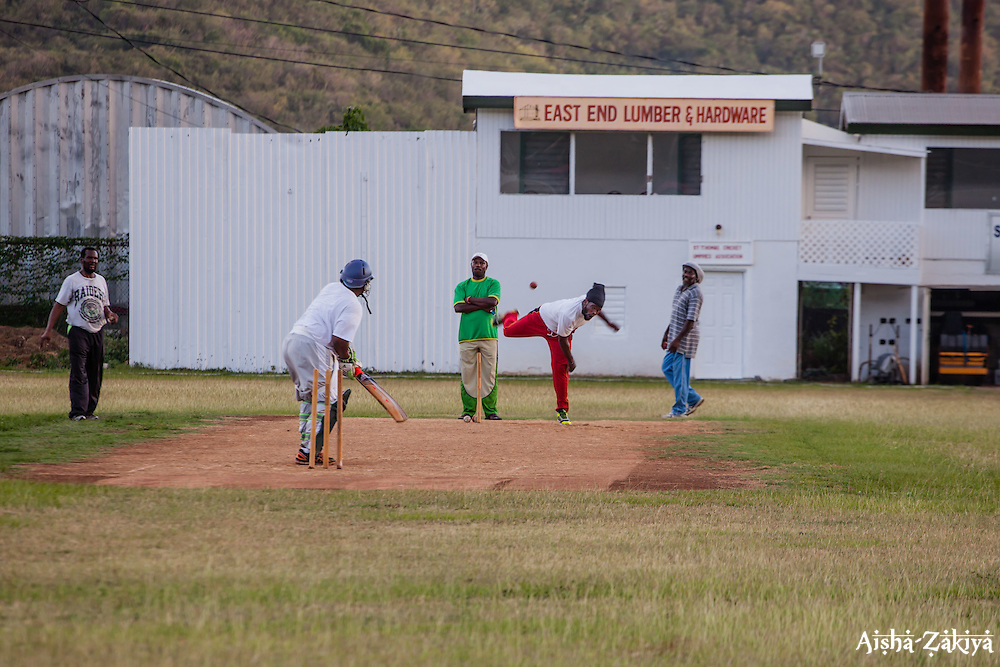 Shannim Phillip throws a pitch.  Players of the 40 and over cricket team practice for an upcoming tournament at Addelita Cancryn field.  St. Thomas, USVI.  14 April 2015.  © Aisha-Zakiya Boyd