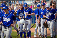 Coeur d'Alene High's Devon Austin, left, is congratulated by his teammate Jake Matheson after hitting a three-run homer against Lake City in the Viking's 13-1 win Thursday.