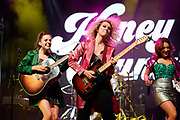 NASHVILLE, TENNESSEE - OCTOBER 21: L to R Katie Stump, Devon Jane and Dani Rose of Honey County perform at Wildhorse Saloon on October 21, 2019 in Nashville, Tennessee. (Photo by Mickey Bernal/Getty Images)