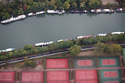 View of tennis courts along La Seine river in Paris, France. (southwest of La Grande Arche de la Defense).