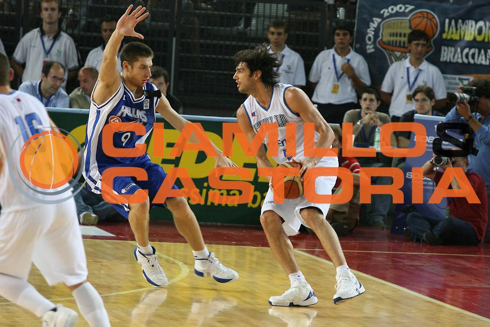 DESCRIZIONE : Roma Amichevole preparazione Eurobasket 2007 Italia Grecia <br />GIOCATORE : Basile<br />SQUADRA : Nazionale Italia Uomini <br />EVENTO : Amichevole preparazione Eurobasket 2007 Italia Grecia <br />GARA : Italia Grecia <br />DATA : 30/08/2007 <br />CATEGORIA : Palleggio<br />SPORT : Pallacanestro <br />AUTORE : Agenzia Ciamillo-Castoria/G.Ciamillo