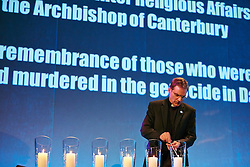 © Licensed to London News Pictures.  28/01/2013. LONDON, UK. Reverend Dr Toby Howarth (pictured) lights a candle at the Holocaust Memorial Day 2013 UK Commemoration event held today in the QE2 conference centre. The annual event is held to remember genocides across the globe including the holocaust, Bosnia, Cambodia, Rwanda and Darfur.  Photo credit :  Cliff Hide/LNP