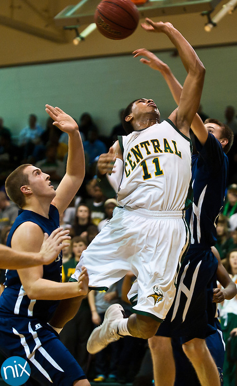 Central Cabarrus' L.C. Cooks goes up for a shot against Hickory Ridge's Garrett Mohre Tuesday night at Central Cabarrus High School. Hickory Ridge won the South Piedmont Conference matchup 71-65. (Photo by James Nix)