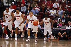 Feb 16, 2012; Stanford CA, USA; Stanford Cardinal guard Aaron Bright (2) dribbles the ball up court after a steal from Oregon State Beavers guard Jared Cunningham (bottom, right) during the first half at Maples Pavilion.  Mandatory Credit: Jason O. Watson-US PRESSWIRE