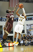 Feb 19, 2011; Long Beach, CA, USA; Long Beach State 49ers guard Casper Ware (22) is defended by Montana Grizzlies guard Will Cherry (5) at the Walter Pyramid. Long Beach State defeated Montana 74-56.