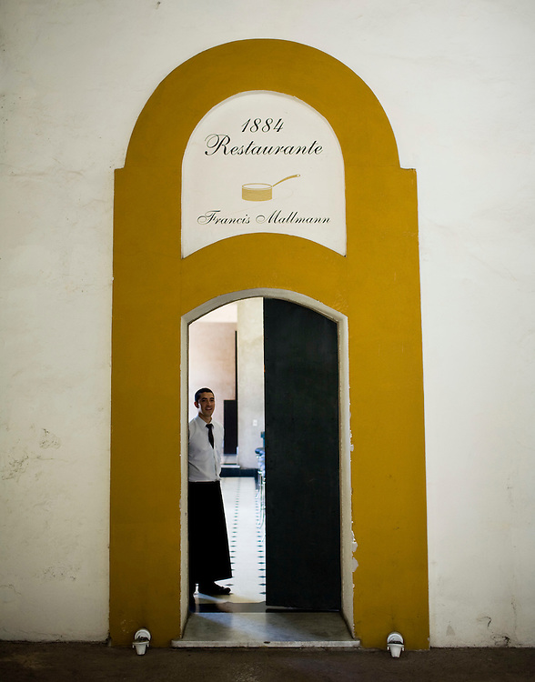 A waiter stands in the entrance to at Francis Mallmann's restaurant, 1884, which is located in the same building as the Bodega Escorihuela in Mendoza, Argentina.