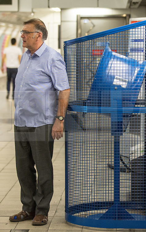 © Licensed to London News Pictures. 01/07/2015. London, UK. A man takes a moment to enjoy a fan at Bank Station on a morning in which commuters and tourists struggle with the intense heat on the London Underground this morning (01/07) on what is set to be the hottest day this decade. Photo credit : James Gourley/LNP