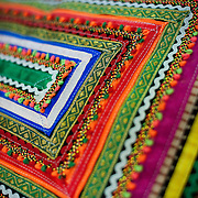 Judy Frater is an American anthropologist who has started a design school to teach villagers in Gujarat how to make traditional textiles. Here at the  Kala Raksha craft sale in Dehli, the women sell various items and accessories made of these traditional fabrics.   (www.kala-raksha.org). New Delhi, October 2009