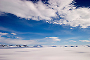 Shadow of clouds across the Greenland ice cap during a British mountaineering expedition to Knud Rasmussens Land, East Greenland, Arctic, 2006.