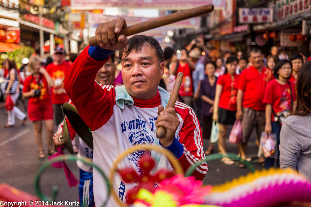 31 JANUARY 2014 - BANGKOK, THAILAND:   A drummer for Chinese Lion dance troupe performs on Yaowarat Road during Lunar New Year festivities, also know as Tet and Chinese New Year, in Bangkok. This year is the Year of the Horse. The Lion Dance scares away evil spirits and brings prosperity and luck. Ethnic Chinese make up about 14% of Thailand and Chinese holidays are widely celebrated in Thailand.     PHOTO BY JACK KURTZ