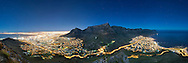 Night-time, moonlit panoramic of the city of Cape Town and Table Mountain.