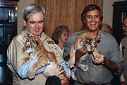 U.S Speaker of the House, Newt Gingrich, left, holds a tiger cub along side Jack Hanna, director of the Columbus Ohio Zoo on Capitol Hill June 27, 2015 in Washington, DC.