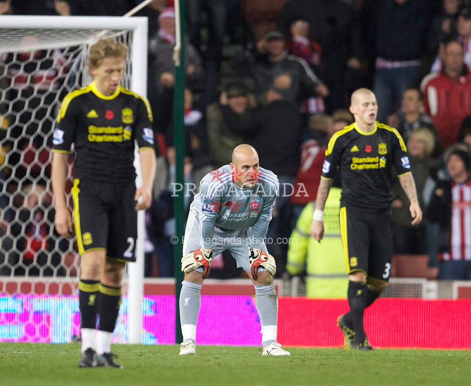 STOKE, ENGLAND - Saturday, November 13, 2010: Liverpool's Lucas Leiva, goalkeeper Jose Reina and Martin Skrtel looks dejected after conceding Stoke City's second goal during the Premiership match at the Britannia Stadium. (Photo by David Rawcliffe/Propaganda)