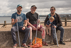 The Commonwealth Games Queen's Baton came to Portobello Beach and it still wasn't the biggest thing happening there. The Big Beach Busk, now in its eighth year was just getting underway when the Baton arrived at the beach volleyball courts by Portobello Baths where a Men's CEV Continental Tour competition was underway. Pictured: Paul Lambie (centre) the inspiration for the Beach Busk with two of his 'chalkers' having set up the chalk 'stages' down the prom.<br /> <br /> <br /> © Jon Davey/ EEm