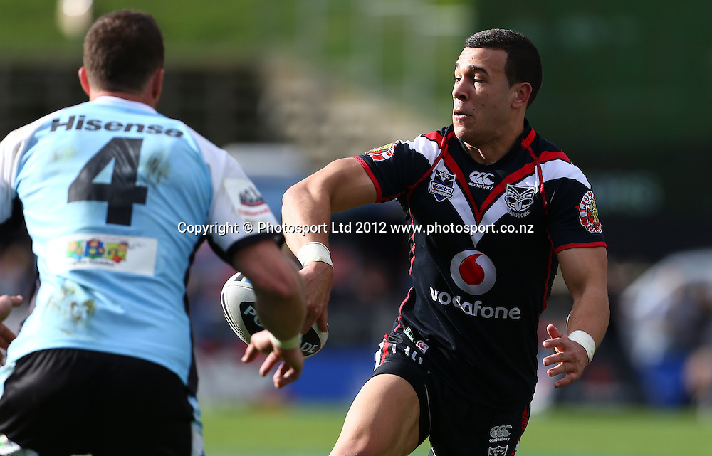 Carlos Tuimavave of the Warriors offloads during the NRL game, Vodafone Warriors v Cronulla Sharks, Mt Smart Stadium, Auckland, Sunday 5 August  2012. Photo: Simon Watts /photosport.co.nz