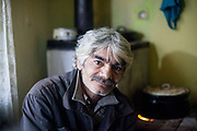 """Portrait of Rudolf (52) in  the familie's selfconstructed house. He and his family are among those who joined the micro loan program in Rankovce. """"They and their son Rudo and three small grandchildren have never lived in their own home. They have been homeless or lived in a caravan without drinking water and electricity. Rudolf is educated as a gardener and since the fall of communism he has not been able to get a permanent job."""