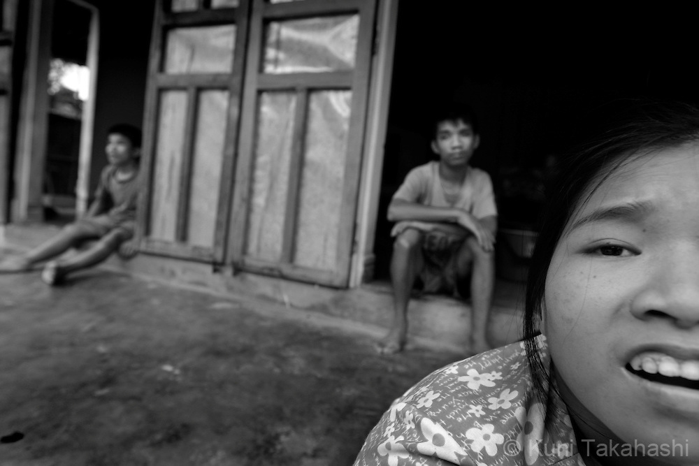 Children of Tran Van Tram, 60, sit at their house in Quang Tri Province in northern Vietnam on June 25, 2009. .Tram, who lived in Cam Lo, one of the most heavily sprayed areas during the war, has seven children and four of them have severe developmental disabilities....
