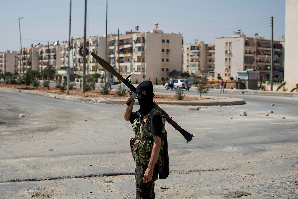 A Free Syria Army (FSA) fighter takes guard at a rebel checkpoint near Circle of Jambul in northeast Aleppo.