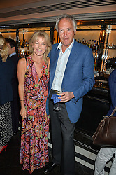EMMA WILLIS and her husband RICHARD CORFIELD at the Style for Soldiers dinner held at Le Caprice, 20 Arlington Street, London on 24th May 2016.
