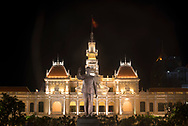 A statue of Ho Chi Minh in front of the People's Committee Building at night in Ho Chi MInh City, Vietnam, Southeast Asia