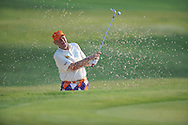 Golfer John Daly blasts out of a bunker on the first hole at the PGA FedEx St. Jude Classic at TPC Southwind in Memphis, Tenn. on Thursday, June 9, 2011.