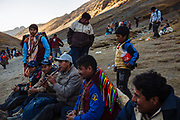 Pilgrims take a break while one of them touches the quena after attending the festival that worships the Lord of Qoyllur Rit'i, in Cusco, Peru.