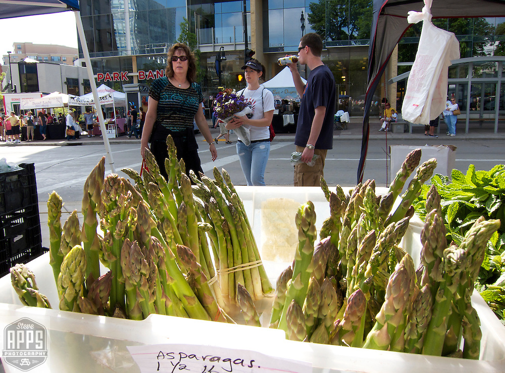 .Asparagus for sale at the farmers market. .The Dane County Farmers Market is held Saturday mornings from early April through early November on the Capitol Square in Madison, Wisconsin.
