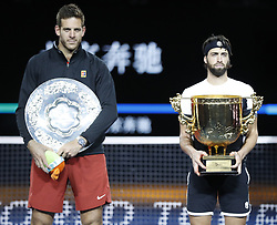 BEIJING, Oct. 7, 2018  Winner Nikoloz Basilashvili (R) of Georgia and runner-up Juan Martin del Potro of Argentina pose during the awarding ceremony of the men's singles event at the China Open tennis tournament in Beijing, capital of China on Oct. 7, 2018. (Credit Image: © Xinhua via ZUMA Wire)