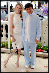 Jackie Chan in Cannes with actress Laura Weissbecker pose for photographers while promoting his new film Chinese Zodiac, Friday 18th May 2012. Photo by Andrew Parsons/i-Images.