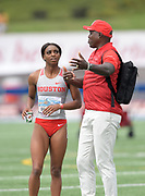 Apr 19, 2019; Torrance, CA, USA; Houston Cougars assistant coach Carl Lewis (right) talks with Ashley Seymour  during the 61st Mt. San Antonio College Relays at El Camino College.