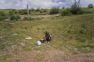 A soldier from Nagorno-Karabakh sits by the road outside a military base on Sunday, May 8, 2016 in Talish, Nagorno-Karabakh.
