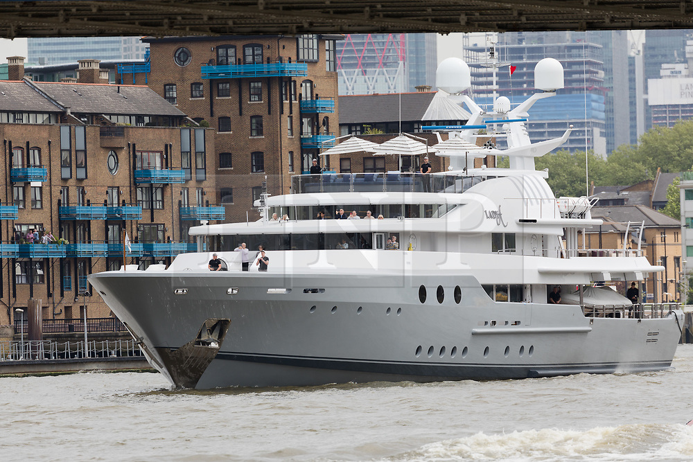 © Licensed to London News Pictures. 13/05/2018. London, UK. Alan Sugar sails his luxury superyacht, Lady A on the River Thames this afternoon as it approaches Tower Bridge and parades in the Upper Pool in central London, before passing under Tower Bridge again and travelling east along the river. Alan Sugar reportedly purchased the 181 feet long yacht in 2015 and renamed her Lady A after his wife, Ann and it includes a jacuzzi and can sleep up to 12 guests. Lady A is reportedly still up for sale at around £13m after being put on the market last year, or it can be chartered with prices starting from around £12,500 per week. . Photo credit: Vickie Flores/LNP